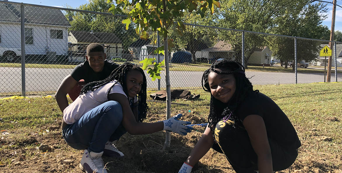 Planting trees at Hopewell's DuPont Elementary School