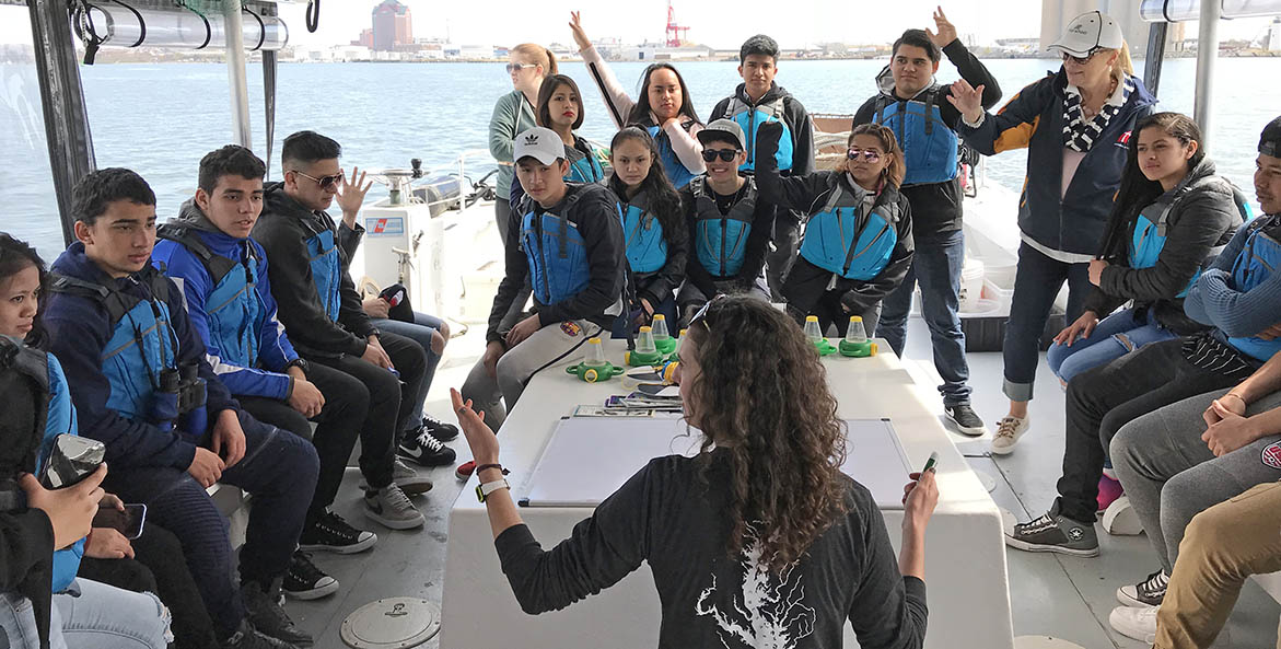 Students on a boat in Baltimore Harbor.