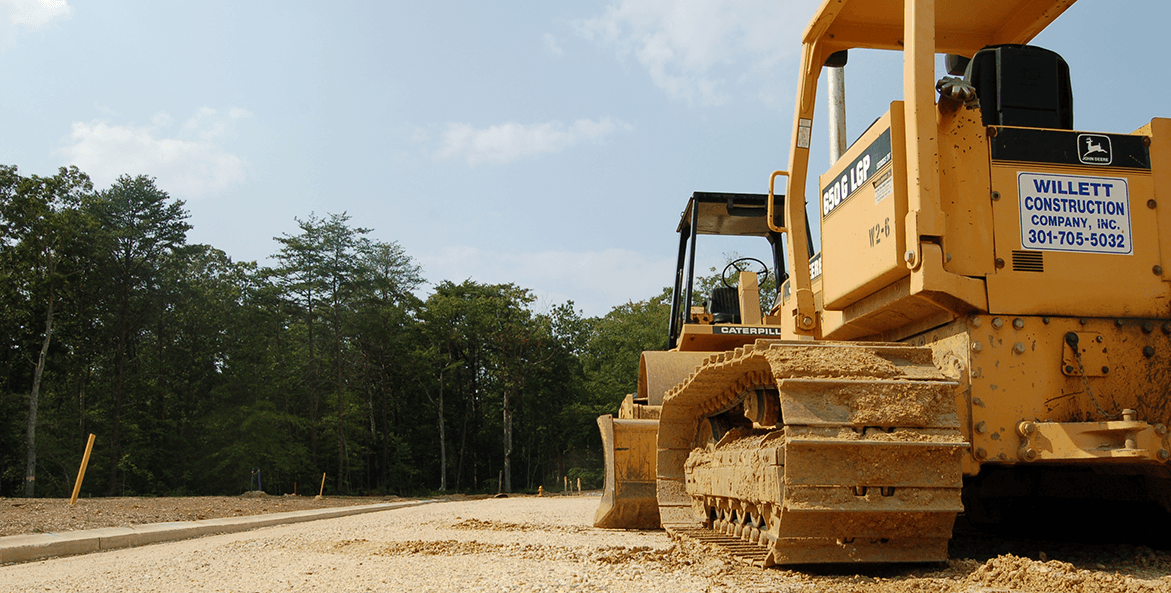 A bulldozer stands at the ready to clear forests.