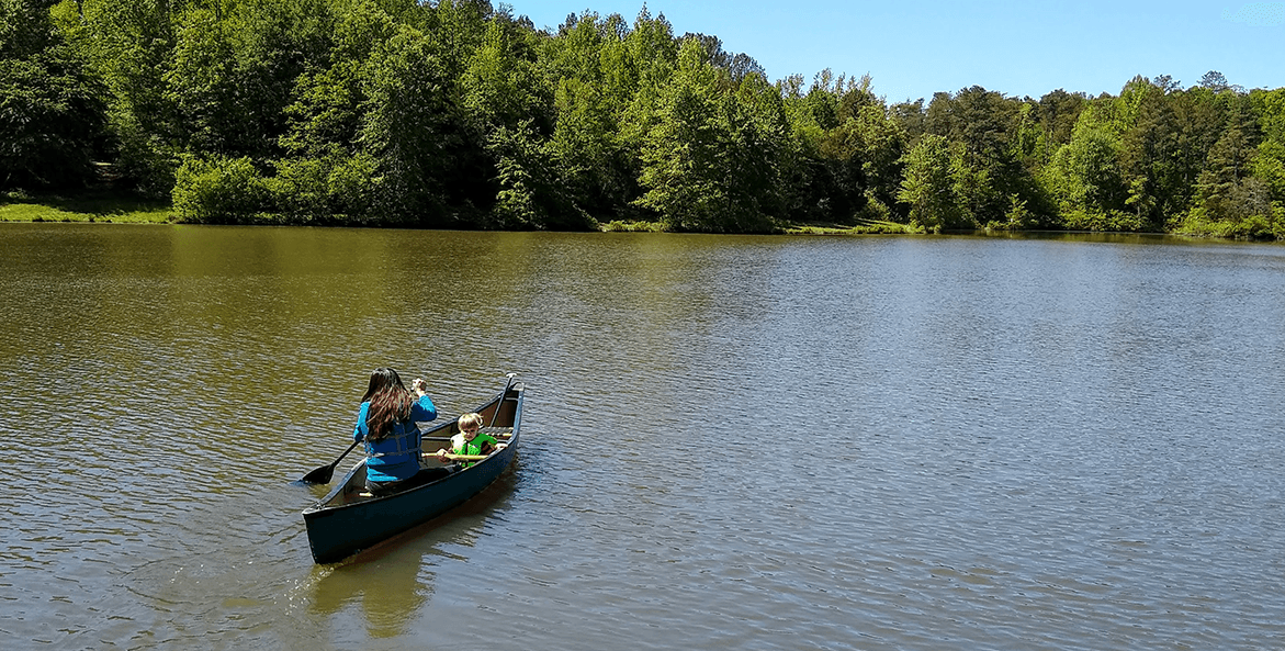 Woman canoeing with her child