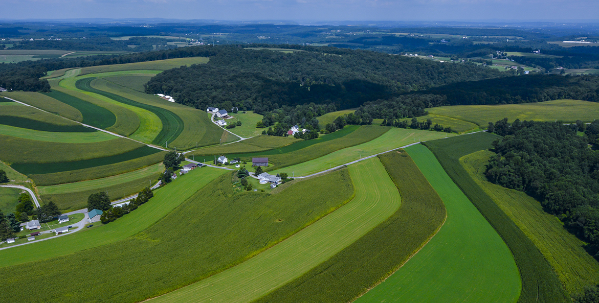 Ribbons of different crops cut across rolling hills in Pennsylvania's York County.
