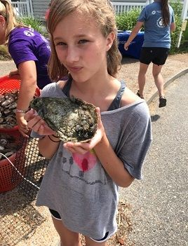 Eloise Caudle holds an oyster.