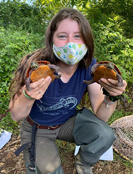 Picture of woman holding two turtles