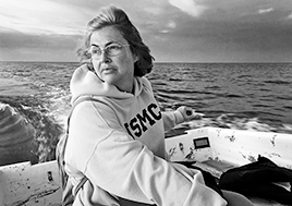 Carol Moore looks longingly at Tangier Island as she maneuvers her boat around the island.