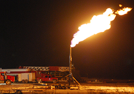 Fire spouting from natural gas drilling.