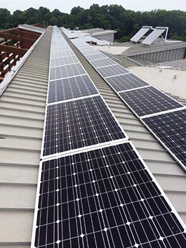 Two rows of solar panels on the roof of CBF's Philip Merrill Environmental Center.