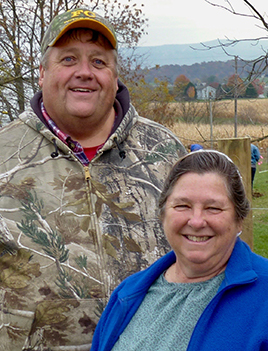 Portrait photo of Glen and Arlene Reid on thier farm in the Linville Creek Watershed.