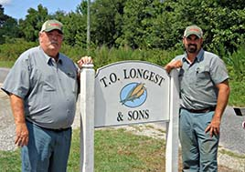 A photo of Thomas Longest and Kevin Norman on their farm