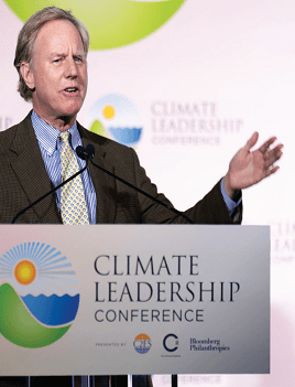 Will Baker speaks from a podium bearing the Climate Leadership Conference logo.