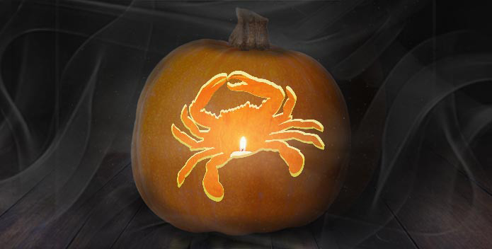 Image of a crab carved into a Halloween pumpkin.