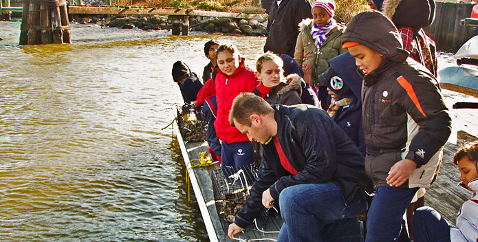 oyster-gardening-Tide-Point-Dock-Baltimore-UnderArmour-students_byCBFStaff_695x352.jpg