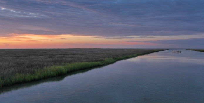 Image of a lone waterman at sunset.