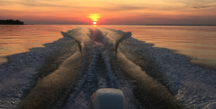 An image of a sunset on the water.