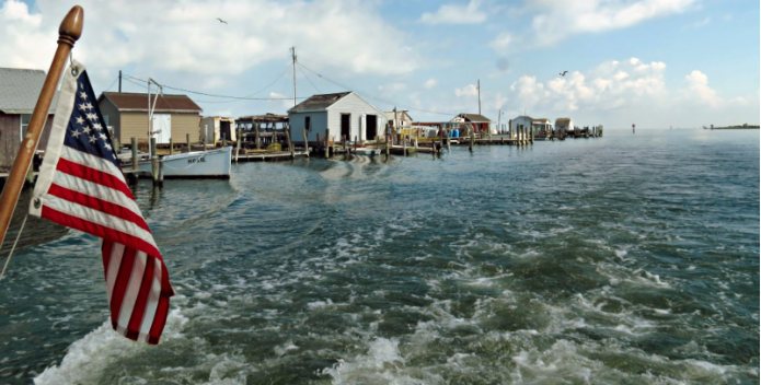 Image of crab shacks lining Tangier Island.
