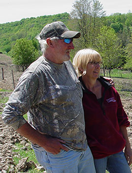 Photo of Terry and Patti Bennet on their farm in Montrose, PA.