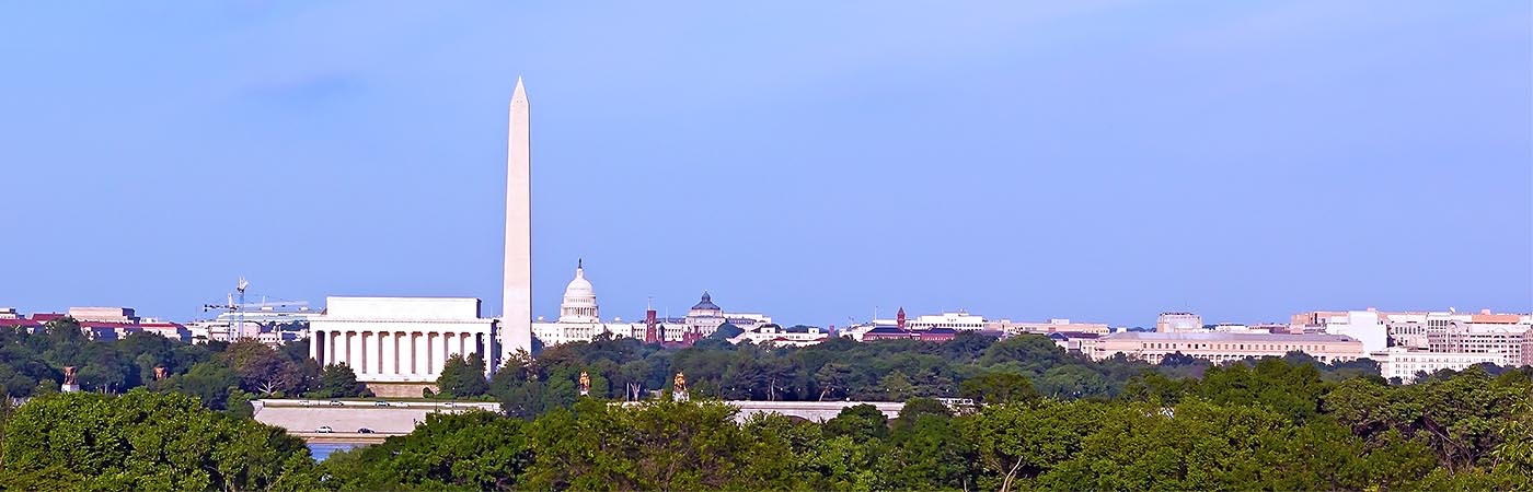 Panoramic view of Washington, D.C. including the Washington Monument and the Capitol building.