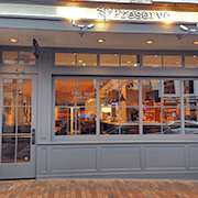 Restaurant storefront with glass door and large windows.