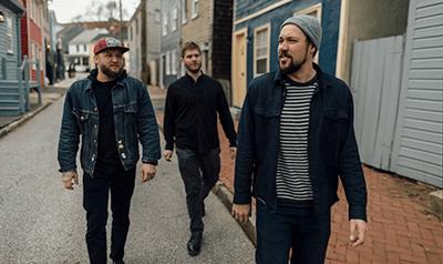 Four men walking down an Annapolis street.