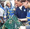 Students examine their catch in a crab trap. Photo by CBF Staff