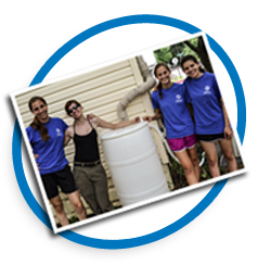 Students with rain barrel. Photo credit CBF Staff.