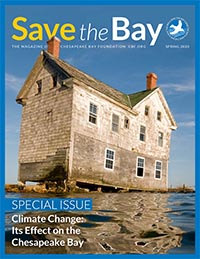Magazine cover with photo of decrepit house completely surrounded by water.