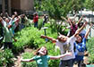 Students rejoicing in a garden.