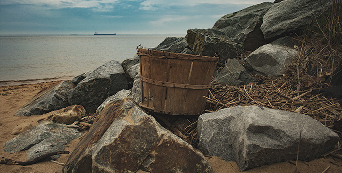 A bushel on a beach overlooking the Chesapeake Bay.