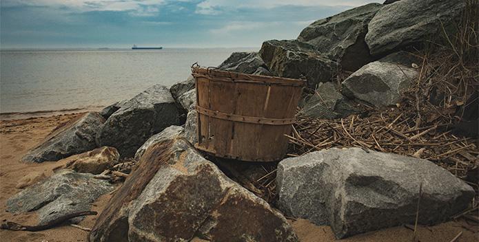A bushel on a beach overlooking the Chesapeake Bay.