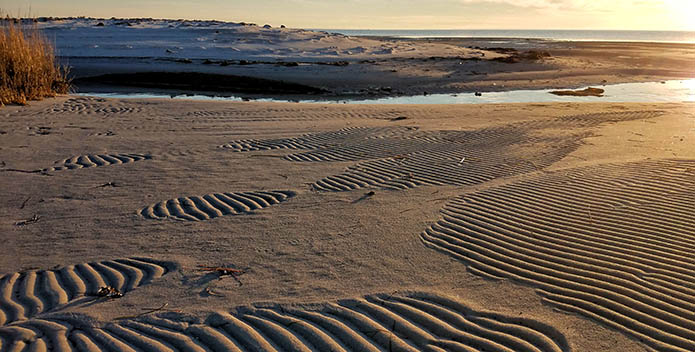 Photo of the patterns left in the sand after the tide water recede.