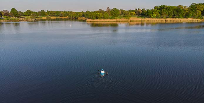 A photo of a lone kayaker on Bear Creek.