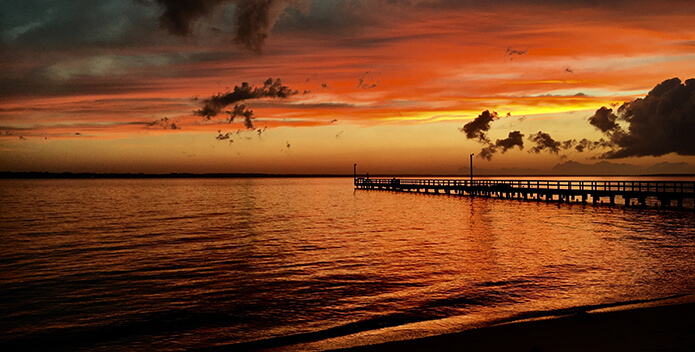 A vibrant orange sunset over the Rappahannock River.