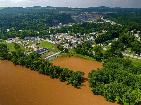 An aerial view of neighborhoods along the muddy, overflowing Susquehanna.